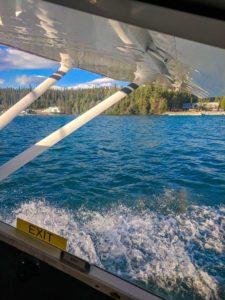 Cessna floatplane taking off on a lake, Whitehorse